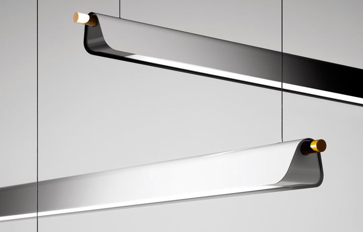 stockholm-based firm note design studio has completed 'trapets', a fluorescent pendant fixture for swedish manufacturer zero.   based on the idea of the trapeze, the traditional shape is playfully reinterpreted with an aluminum shade folded onto a wooden pole.   the draped form, available in white, silver and black, gently directs the light. the fixture is equipped with a T5 eco fluorescent tube light.