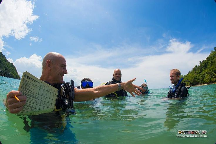 Richard holds his hand out to Dominik to demonstrate positive reinforcement for a student diver :)