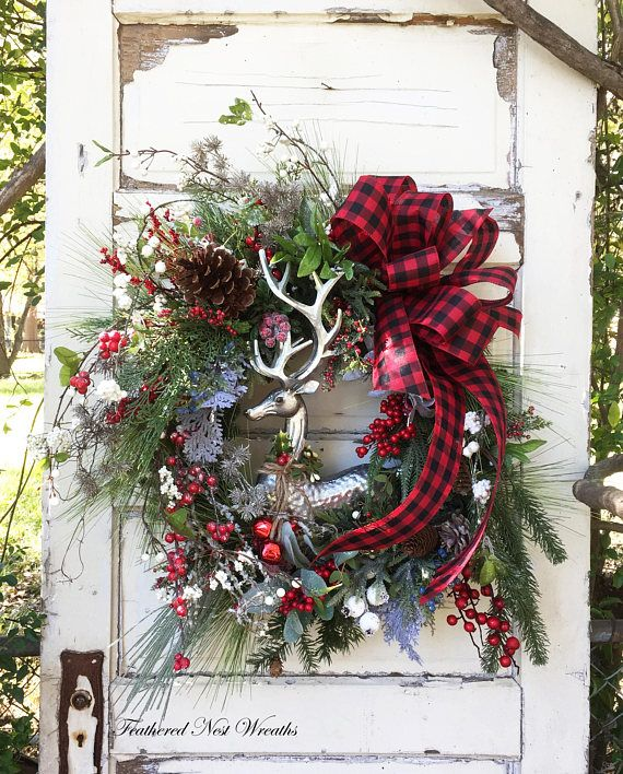 This Elegant Woodland Wreath is made on a Pine Base. I have added a Mixture of Christmas Pines, Red Berries, Icy Twigs, White Winter Berry Twigs, Small Herbs, Juniper Berries, Some Sparkly Silvery Gold Twigs and Faux Boxwood with Cream Berries. I have added a Beautiful Silver