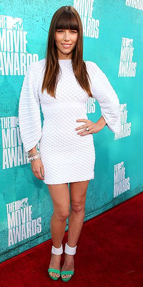 JESSICA BIEL  It's not that white dress, but the textured mini with dramatic sleeves is good practice for the bride-to-be, who pairs it with white-and-green heels, blunt bangs and her enviable engagement bling.