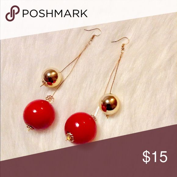 Red & Gold Dangle Earrings Double Ball Drop Earrings in Red & Gold   Top off any casual outfit with these cute double drop earrings! Polished with a bright shine.   *High quality costume jewelry  *Gold chain drop  *NEW  *Lightweight Jewelry Earrings