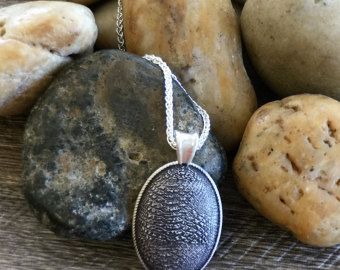 This sterling silver oval texture pendant is one of the latest in a range from Louise Alan Jewellers  The Sterling silver oval pendant is oxidised and each piece is engraved on the back.  Check out the others at;   https://www.etsy.com/au/shop/LouiseAlanJewellers?ref=hdr_shop_menu