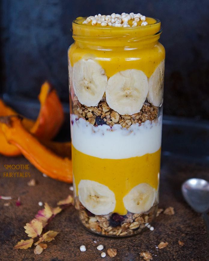 A delicious and gorgeous layered breakfast jar made with spicy pumpkin smoothie, granola and bananas. It's perfect for breakfast or as a meal replacement.