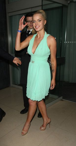 Helen Flanagan Lookbook: Helen Flanagan wearing Cocktail Dress (9 of 21). Helen Flanagan rocked a teal cocktail dress with a halter neckline and a pleated skirt for her look at FHM's Sexiest Woman Launch Party in London.
