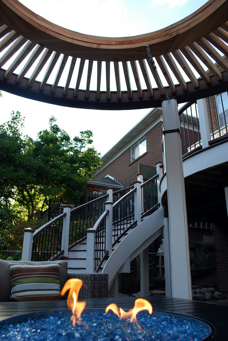 """Curves, curves, curves!  A funky design with a curved upper deck & staircase overlooking a circular pergola.  From """"Decked Out"""" episode """"The Circular Pergola Deck"""".  Design by Paul Lafrance Design."""