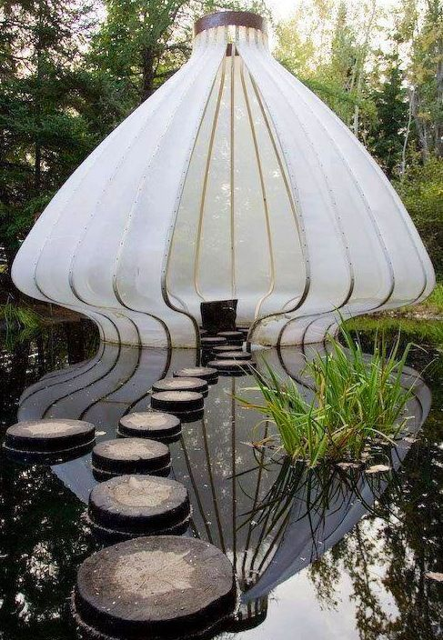 Cool architecture in lake image via Namaste Cafe at www.Facebook.com/NamasteDharmaCafe