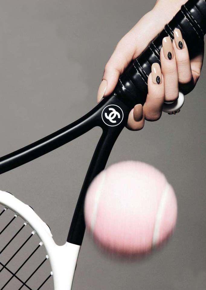 Chanel tennis racket. Pink tennis ball.