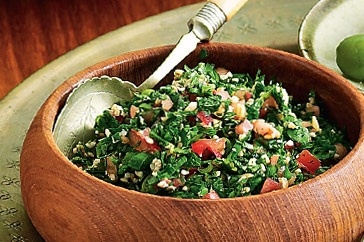 Tabouli - 1. Place 1/3 Cup Bulgur + 1/4 Cup Lemon Juice + 2 Lge finely Chopped Tomatoes    Let soak for about 30mins or until Bulgur is soft  2. Chop & Add: 2 Bunches of flat leaf Parsley + some mint (1/4-1/2 bunch)+ 4 Green Onions  + 1/4 Cup Olive Oil
