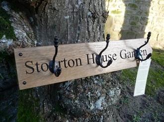English oak Stourton sign with acorn-tip hooks (Ref. SH0163), hooked on hooks