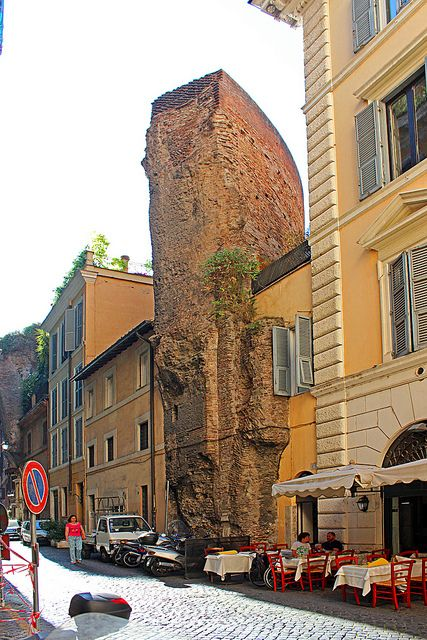 """Working around History, The Doughnut Arch Street - This photo is of interest due to the subject, the remains of the earliest Roman Public Baths which have newer buildings built directly around them. Because of the shape he ruins, the street is called via dell'Arco della Ciambella, more or less """"Doughnut Arch Street""""."""