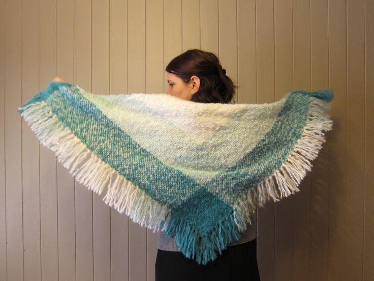 A triangular woven Shawl by LesFousDart.