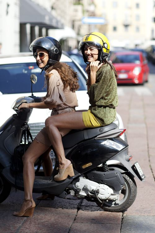 two lovely ladies on a motorbike in platforms in italy. what part of that sentence do i not love?