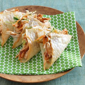 Wonton tacos :: Nonstick cooking spray  8 wonton wrappers  4 ounces cooked, shredded skinless chicken breast (1 cup)  2 tablespoons barbecue sauce  3/4 cup packaged coleslaw mix  2 tablespoons low-fat sesame ginger dressing  2 tablespoons chopped fresh cilantro