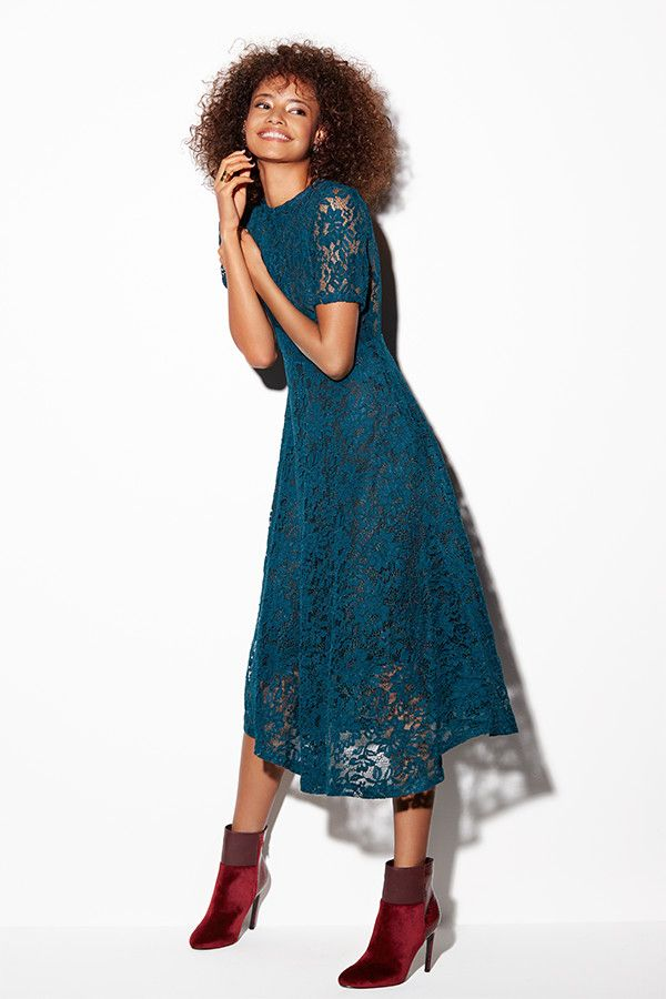 The beauty of Sister Jane's rich teal lace dress lies in its versatility. A romantic choice for the flurry of festive parties, heighten the jewel colour palette with tonal accessories then once the madness has calmed down, layer with a polo knit and add knee-length leather boots as you discover the New Year. Sister Jane Brunswick dress; Another Pair of Shoes Aliyah boots; Ted Baker Lorel Rose earrings; Wouters and Hendrix Gold ring