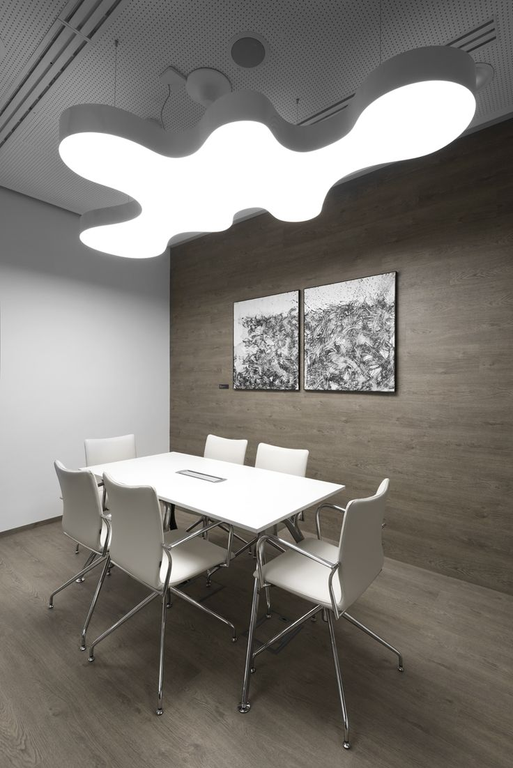 Work space combined with art pieces by contemporary Czech artists. A sneak peek of meeting rooms of PRO.MED.CS Praha.