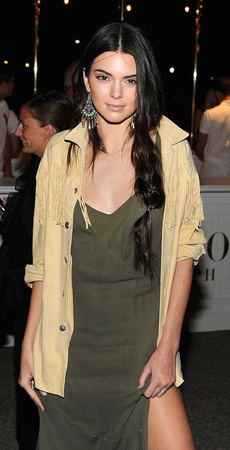 Kendall Jenner paired her thick, loosely woven braid with a fringed suede jacket and an army green slip dress