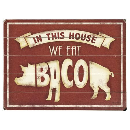 We Eat Bacon Wall Decor A whimsical addition to your kitchen, this charming paneled wood wall decor showcases a pig design with weathered text detailing.