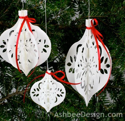 handcrafted paper Christmas ornaments from Ashbee Design ... used cutting file on  Silhouette machine ... luv the lacy floral patterns cut in the bauble shapes ...
