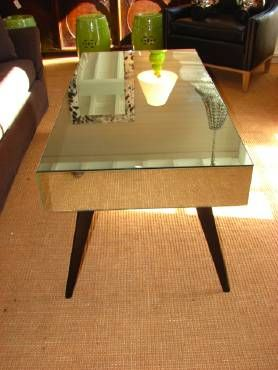 Discontinued Item Limited Stock Availalbe 1 in Palm Beach     New York Coffee Table with Spayed Legs and Three Vanishing Drawers Sold in As Is Condition, Final Sale Item ORIGINAL PRICE: $2950.00 NO ADDITIONAL DISCOUNTS APPLY