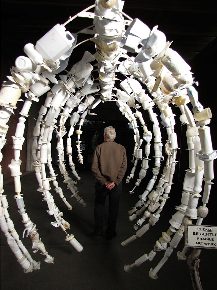 """""""Whale Bone Rib Cage"""" - Abstract Hanging Sculpture using detergent bottles, milk jugs, etc. collected from beaches."""