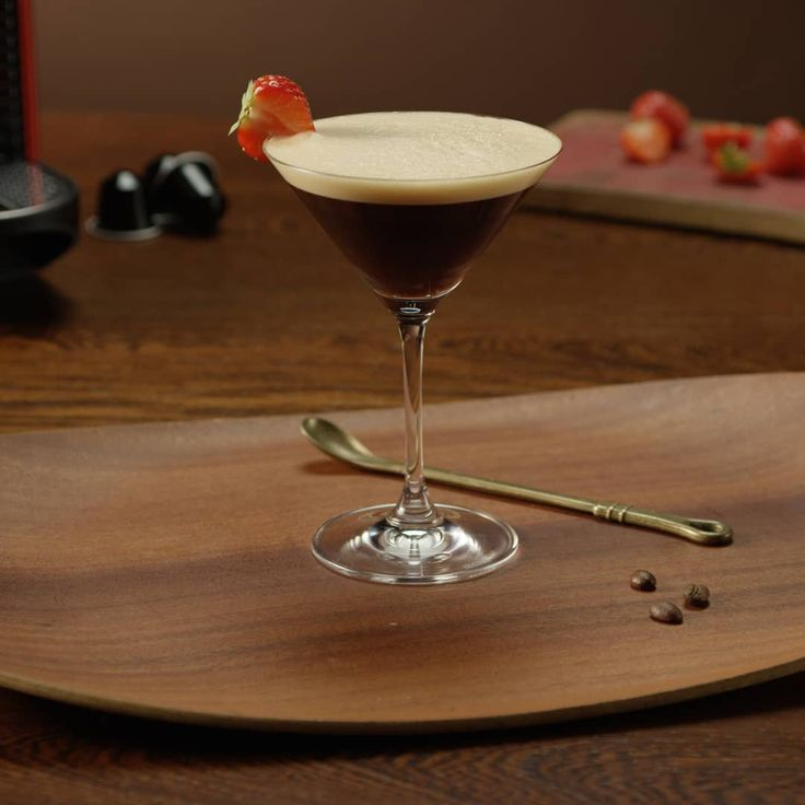 Meet the 🍸 Nespresso Martini Coffee Cocktail* 🍸, a classic with a twist. Perfect for New Years Eve celebrations. #NespressoRecipe #RecipeOfTheDay #CoffeeTime #CoffeeLover. *This recipe contains alcohol. Please drink responsibly.    INGREDIENTS ■ Ristretto (40ml) ■ Vanilla syrup (5ml) ■ Vodka (30ml) ■ Ice cubes (60g) ■ Strawberry (for decoration)    MATERIALS ■ Martini glass ■ Shaker