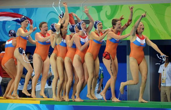 Players of The Netherlands celebrate after defeating the US to win gold in the waterpolo women final at the 2008 Beijing Olympics Games on August 21, 2008. The Netherlands won gold while USA took silver and Australia claimed bronze.