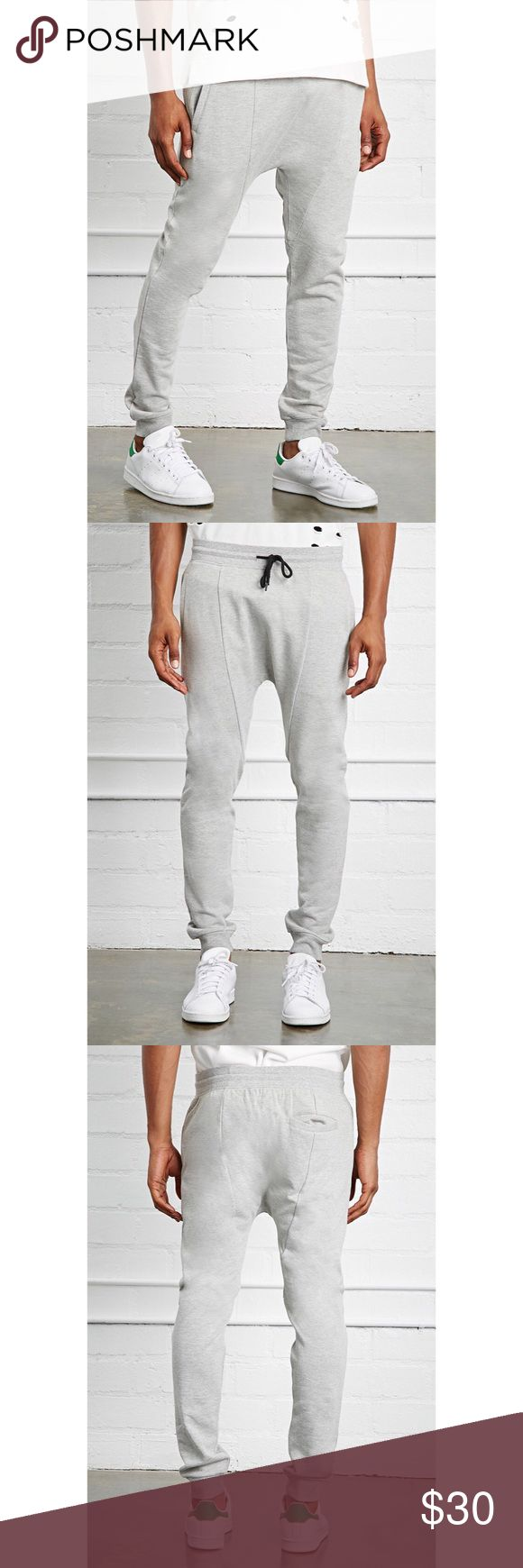 """✨Drop Crotch Joggers✨ ✨A Pair Of French Terry Knit Drop Crotch Joggers With Ribbed Trim, An Elasticized Drawstring Waist, Slanted Front Pockets, And One Back Welt Pocket. Content + Care - 59% Cotton, 41% Polyester  - Hand Wash Cold  - Made In China  Size + Fit - Model Is 6'2"""" And Wearing A Small  - Inseam: 28""""  - Waist: 32""""  - Rise: 14""""✨ Forever 21 Pants Sweatpants & Joggers"""