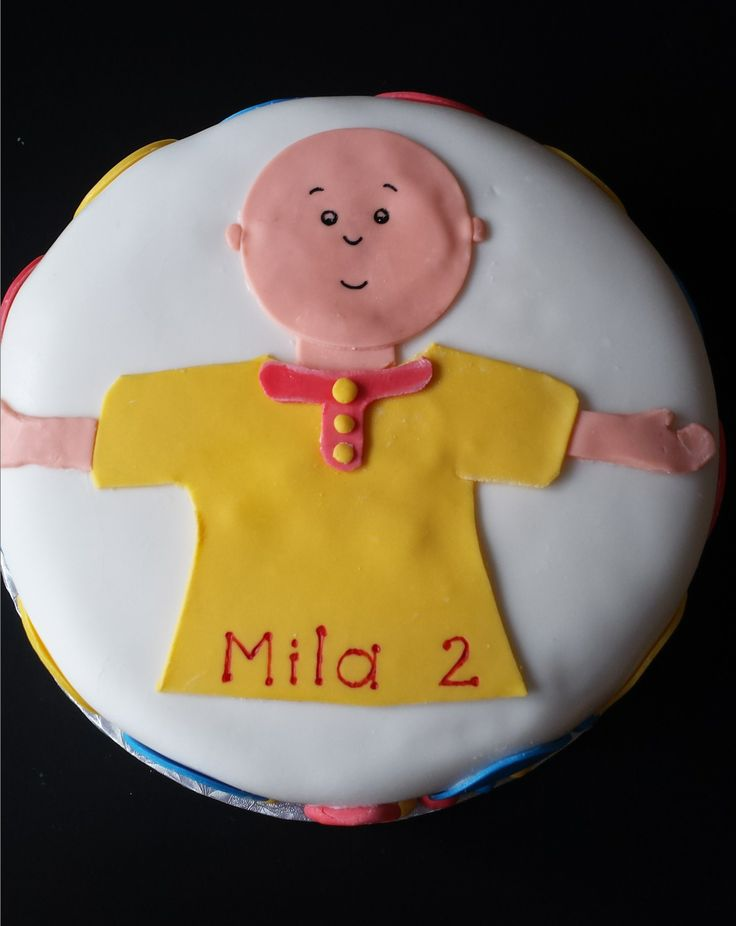 My daughter Mila's 2nd birthday cake. She loves Caillou! Fondant on a double layer chocolate cake.