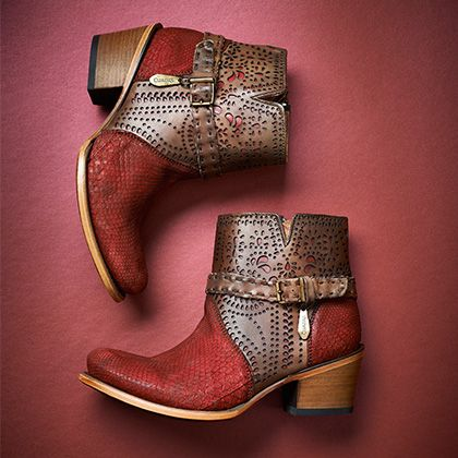 Oxblood snakeskin. Hand tooled leather. Bronze buckle detail. Stacked heel.