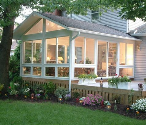 Adding a window-filled sun room is a great way to transition from the indoors to the outdoors.