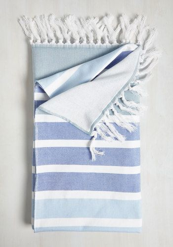 La Plage by Page Beach Blanket. On the first day of your getaway, perch atop this cotton towel and dive into a good book! #blue #modcloth