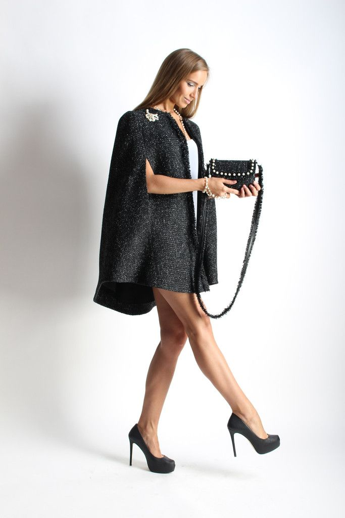 Cape coat with hookes. Layer it over a mini dress and over-the-knee boots.