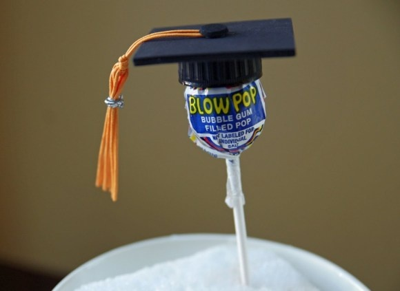 Kindergarten Graduation -- The hat is made out of a spray painted bottle cap and materials available around your home.