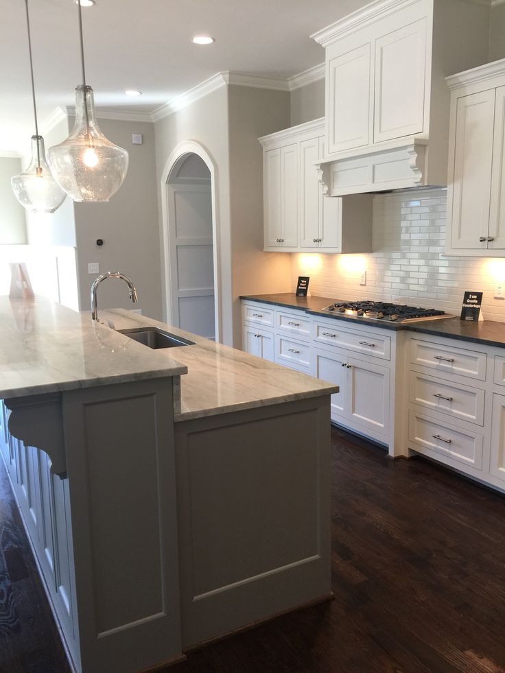 SW Alabaster Cabinets. Mystic Grey Satin Brushed Granite Perimeter  Countertops. Sea Pearl Island