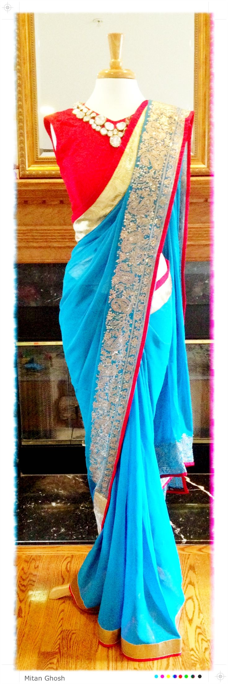 Georgette hand embroidered saree with crystal neckline blouse.