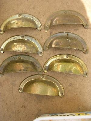 Seven Antique Brass Cup Handles Cupboard Handles
