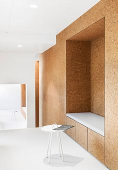 Cork wall with a build in bench.  Love this idea of using the sustainable material such as cork