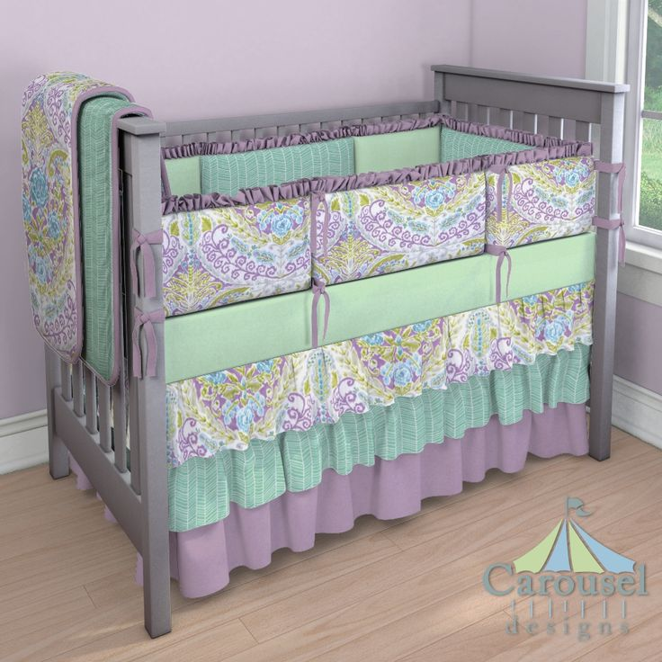 Crib bedding in Mint Herringbone, Aqua and Purple Jasmine, Solid Mauve, Solid Mint. Created using the Nursery Designer® by Carousel Designs where you mix and match from hundreds of fabrics to create your own unique baby bedding. #carouseldesigns