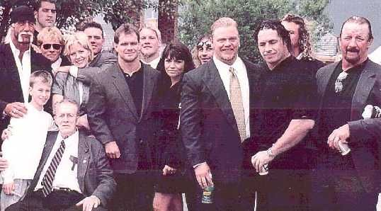From Right To Left: Terry Funk, Bret Hart, Shane Douglas, Nancy & Chris Benoit, Chris Jericho, Davey Boy Smith and Diana, Bruce Hart, Stu Hart, Hulk Hogan At Owen's Funeral
