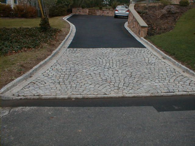 Belgian Block Cubes Set in a Feathered Pattern   Concrete paving, Paving  contractors, Herringbone pattern