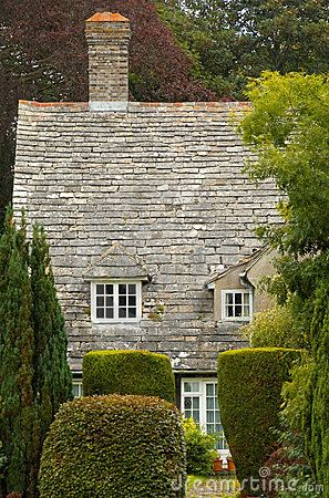 Partial view of an English rural cottage with a slate roof: