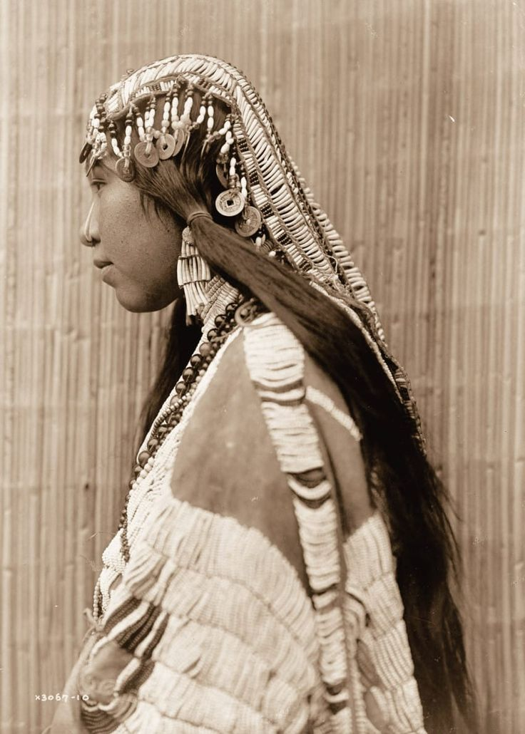 Native American photographs. Why does she have #Chinese coins for her headpiece?