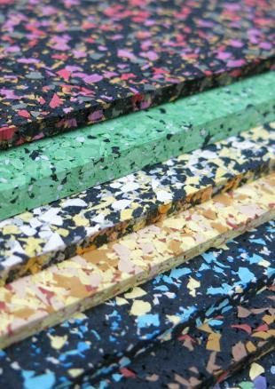 Flecked, coloured, recycled rubber by Mohawk Group at the Surface Design Show…