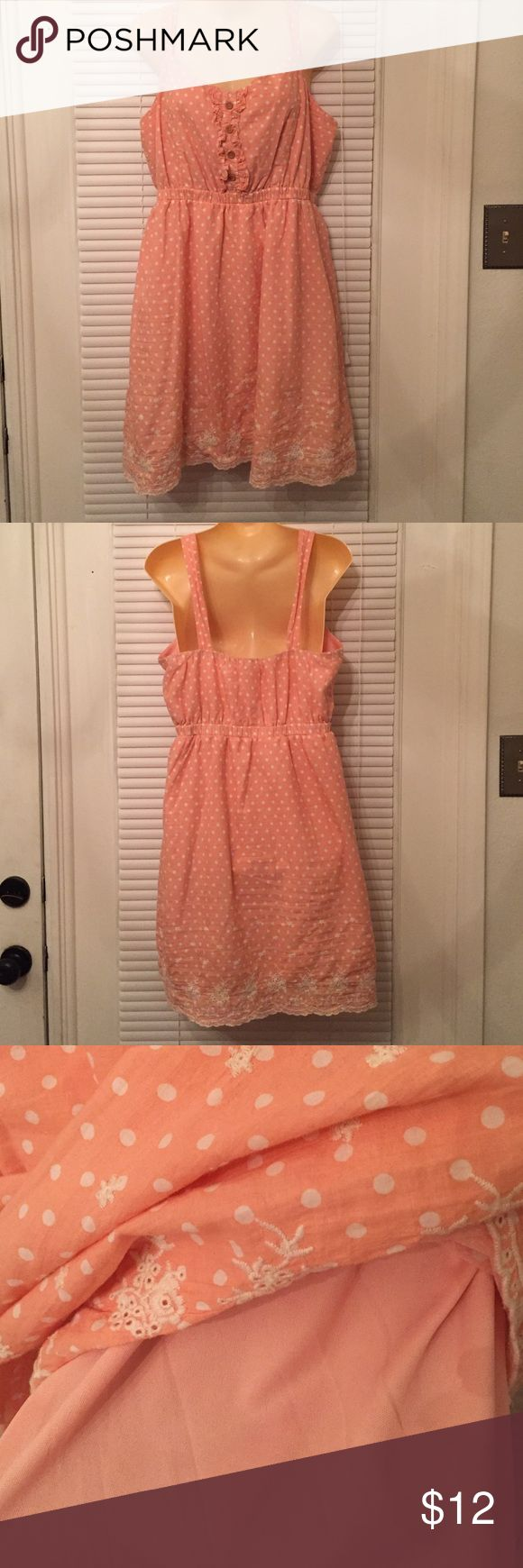 Cute coral sundress that is lined. Cute coral S undress with polka dots and lace at bottom trim. Dress is lined and has thicker straps. Comes from a smoke free and pet free home. Dresses Midi