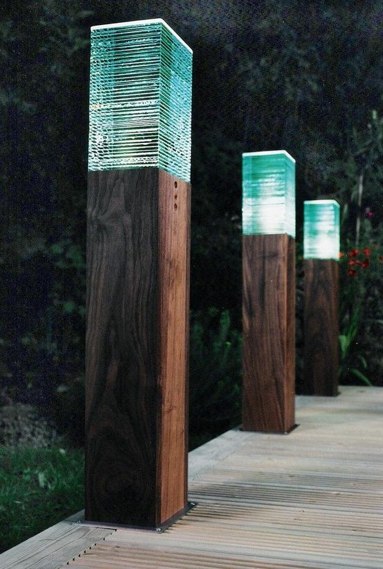The combination of laminated glass on oiled hardwood is impossibly beautiful. This is ambient  outdoor lighting at its shining best.