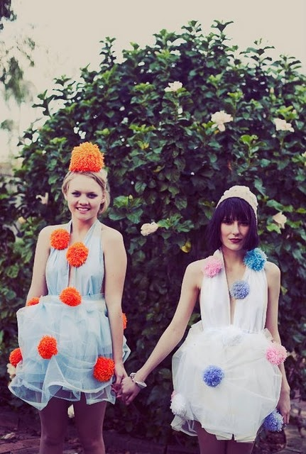 Who are these girls!? Why in the hell are they covered in pom-poms!? (Please be my friend)