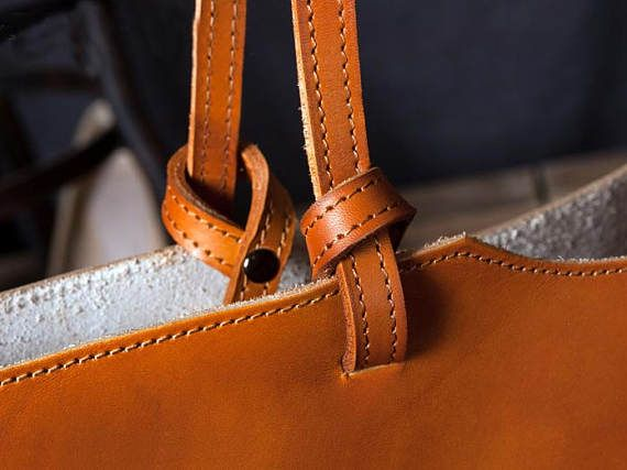 Leather Tote Bag, Leather Bag, Leather Bags women, leather handbag, free shipping, womens leather bag, made in the usa, leather bag handmade   Leather tote bag from simple style. Perfect for road trips, working in the garden, going to school, heading to the farmers market, or over to your working studio!  Straps are natural veggie tanned leather, conditioned with our special blend of oils. Dimensions of bag shown:  11.8 in tall 13 in wide straps measure about 13 in tall weights about 38.8 oz…