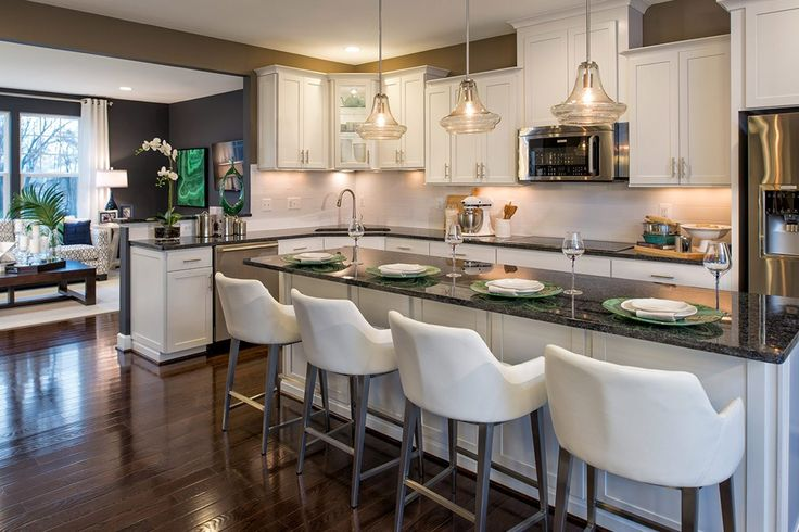 Seeded glass pendant lamps are a distinctive design touch. New townhomes in the Bradley Square community built by by Stanley Martin Homes. Manassas, VA.