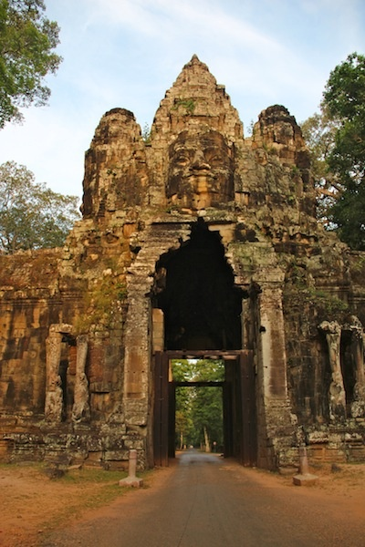 Exploring Angkor Wat... One of the enormous entrance gates to the ancient world of Angkor