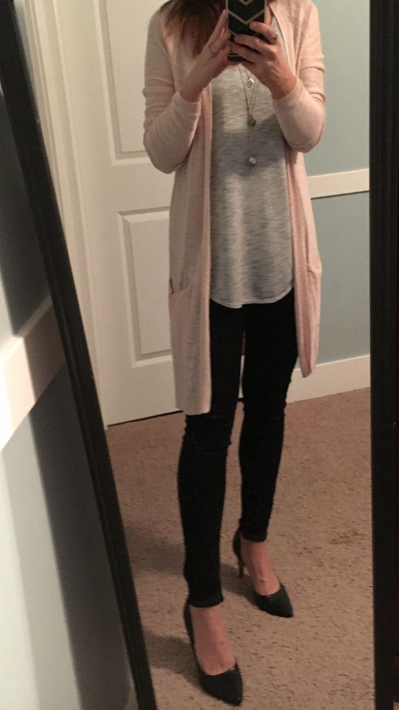Pale pink long cardigan, black & white striped top, black skinny jeans, black he…